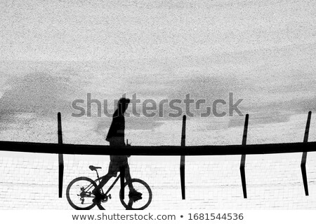 Shadow on Pavement, Man Pushing Bicycle Stock photo © stevanovicigor