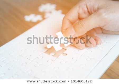 Stock - Puzzle on the Place of Missing Pieces. Stock photo © tashatuvango