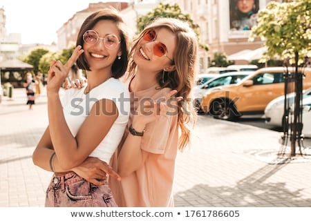 Deux sexy soeurs posant belle brunette Photo stock © oleanderstudio