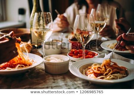 Vacsora étterem több nemzetiségű csoport barátok férfi Stock fotó © iko