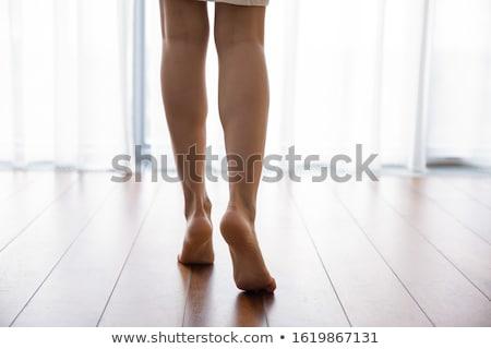 Gyönyörű lány áll mezítláb ablak hátulnézet gyönyörű Stock fotó © deandrobot