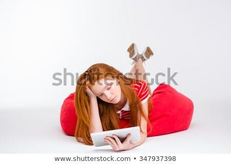 tired exhausted girl lying on bean bag stock photo © deandrobot