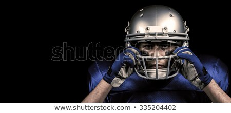 composite image of portrait of american football player holding stock photo © wavebreak_media