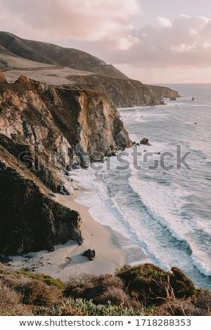 Kustlijn zonsondergang strand water zee Stockfoto © Backyard-Photography
