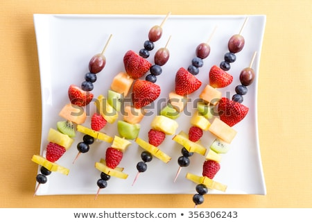 Buffet arrangement of healthy fruit kebabs Stock photo © ozgur