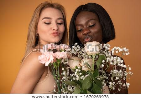 Heureux lesbiennes couple fleurs personnes Photo stock © dolgachov