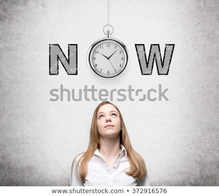 Woman looking what time is it now Stock photo © deandrobot