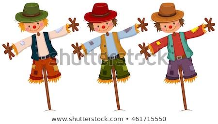 Three scarecrows on wooden sticks Stock photo © bluering