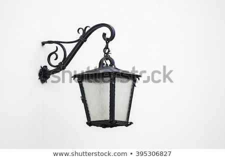 Old street lantern mounted on the wall of a building Stock photo © smuki