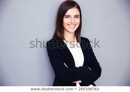 笑みを浮かべて 小さな 女性実業家 立って 手 折られた ストックフォト © deandrobot