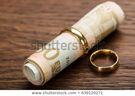 Golden Rings With Rolled Up Euro Notes Stock photo © AndreyPopov