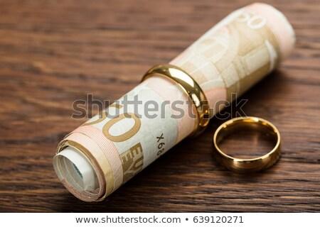 Arany gyűrűk tekert felfelé Euro jegyzetek Stock fotó © AndreyPopov