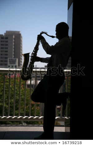 Playing the sax for him. stock photo © Fisher