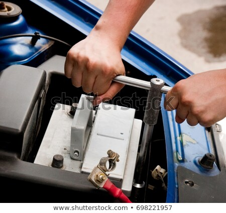 Mechanic at work, process of changing the car battery, closeup s Stock photo © Nobilior