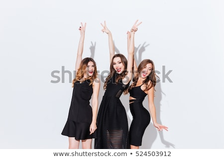 three young women dancing over white background  stock photo © julenochek