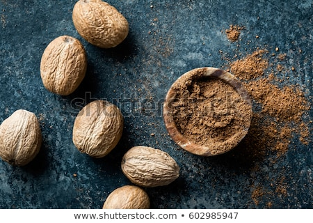 Stock photo: Nutmeg on dark background directly above copy space
