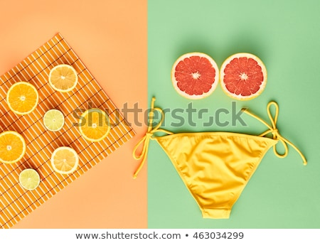 Bikini grapefruit gyönyörű pinup bikini modell tart Stock fotó © Fisher