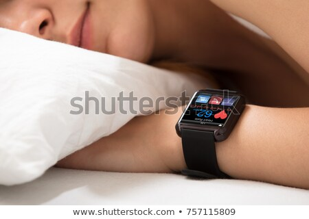 Woman Sleeping With Smart Watch Showing Heartbeat Rate Stock photo © AndreyPopov