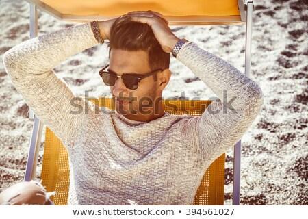Hombre guapo tumbona agua hombre sexy Foto stock © wavebreak_media