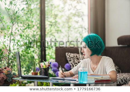 Woman  shielding face with book Stock photo © IS2