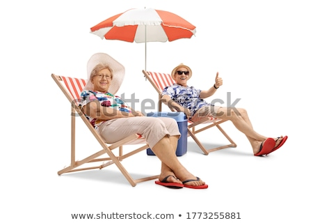 mature couple sitting on beach Stock photo © IS2