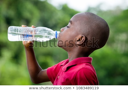 thirsty child drinking water from bottle stock photo © godfer
