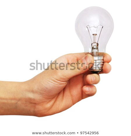Hand of business person holding unlit light bulb. Stock photo © RAStudio
