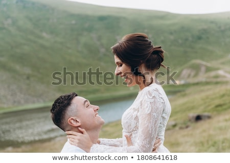 Newlyweds embracing in field Stock photo © IS2
