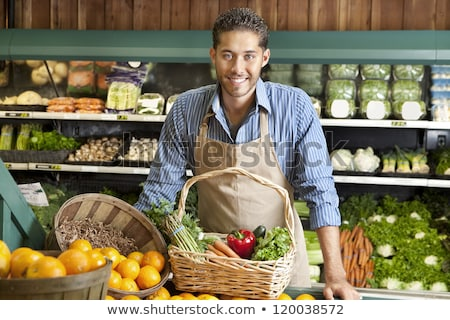 Man standing in front of organic food store smiling stock photo © monkey_business