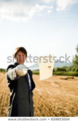 Stock photo: Businessmen fencing in wheat field.