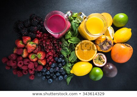 Redcurrant and glass with fruits and drink juice Stock photo © manaemedia