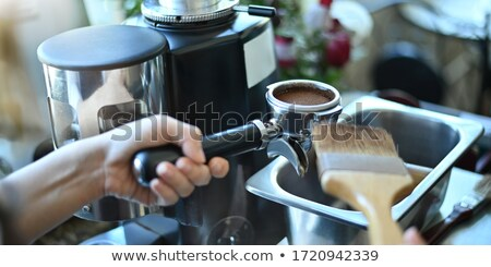 a cup of coffee metal coffee maker and coffee beans in the shape of a question mark on a gray backg stock photo © artjazz