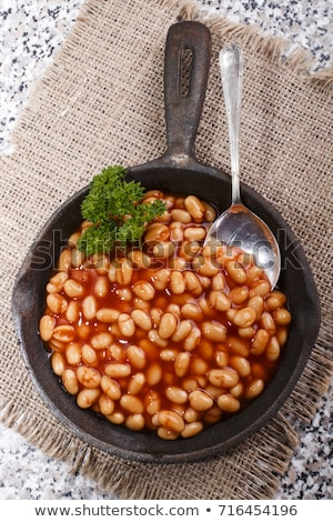 Delicious english breakfast in iron cooking pan Stock photo © dash
