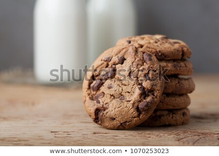milk in a glass bottle and a chocolate chip cookie stock photo © sarahdoow