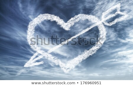 Cloudy white heart with an arrow through it on a background in a color of the year 2019 Living Coral Stock photo © artjazz