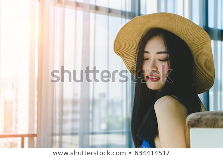 portrait of a lovely asian woman in summer hat stock photo © deandrobot