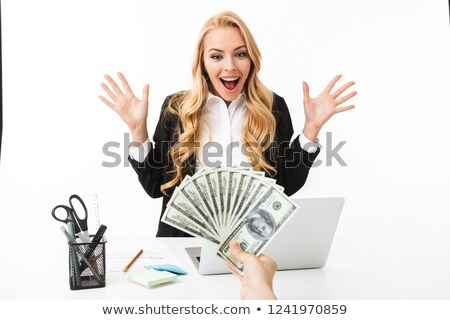 Portrait of delighted woman wearing office clothing grabbing dol Stock photo © deandrobot