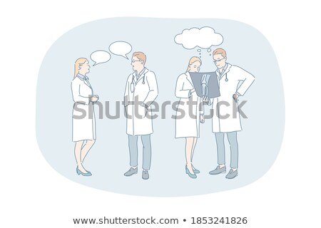 Stock photo: Young Specialists With Stethoscope Having Discussion