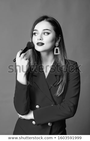 beauty face makeup artist concept cute girl applies red lipstick beautiful woman face make up m stock photo © serdechny