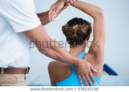 spalla · massaggio · paziente · ritratto · clinica - foto d'archivio © andreypopov