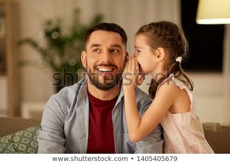 Boldog apa suttog titok lánygyermek otthon Stock fotó © dolgachov