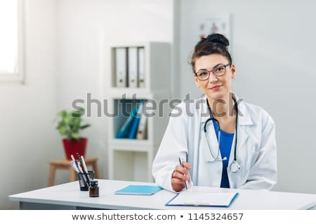 Professional researcher with stethoscope Stock photo © ra2studio