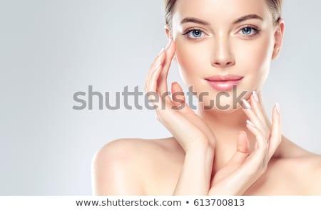 beautiful woman with moisturizing cream Stock photo © dolgachov