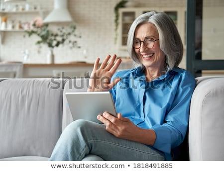 Starszy kobieta okulary technologii starych ludzi Zdjęcia stock © dolgachov