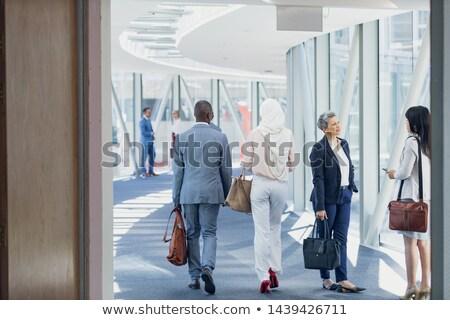 Hátsó nézet elegáns fiatal üzletemberek sétál együtt Stock fotó © wavebreak_media