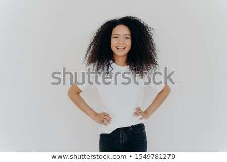 Half length shot of beautiful cheerful millennial girl stands with happy face expression against whi Stock photo © vkstudio