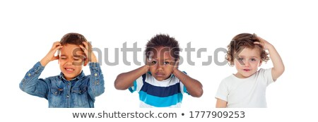 Group of three adorable kids of different ethnicities playing at leisure center Stock photo © pressmaster