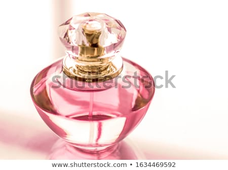 pink perfume bottle on glossy background sweet floral scent gl stock photo © anneleven