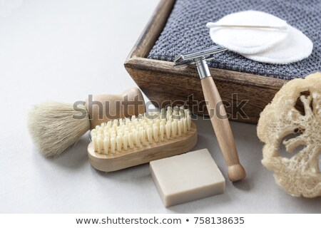 Natural bamboo toothbrush and plastic toothbrush. rustic background. sustainable lifestyle concept.  Stock photo © galitskaya