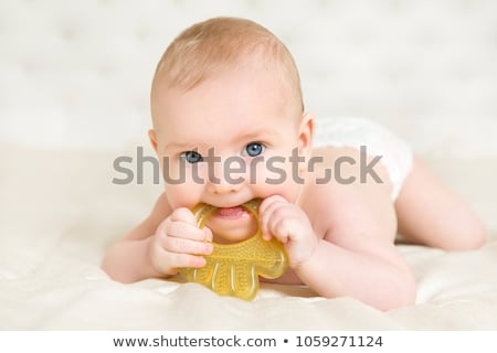baby girl in diaper lying with pacifier on blanket Stock photo © dolgachov